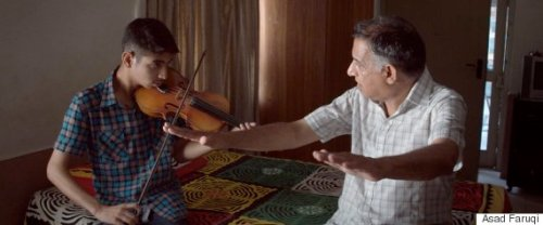 Saleem Khan (left) with his father Hassan Khan, a violinist for the Sachal Jazz Ensemble.